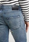 Diesel Black Gold - TYPE PANTALONI - Jeans Slim Fit - blue denim