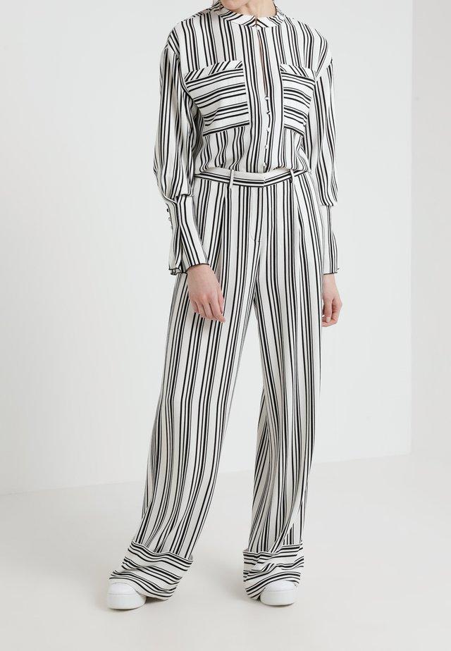 CLEO - Trousers - white/black