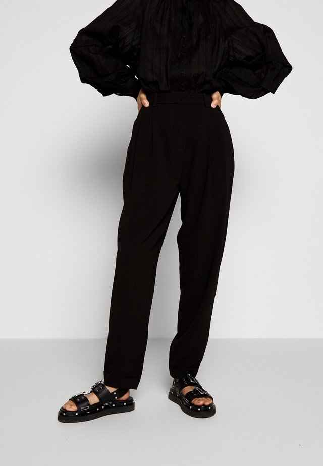 SILVA - Trousers - black