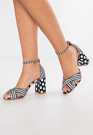 SUNSET - High heeled sandals - black/white