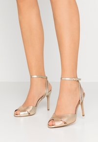 L37 - CROSSFIRE - High heeled sandals - gold - 0