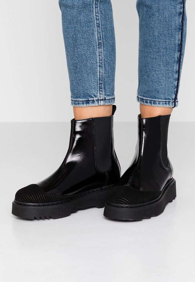 LIFETIME - Platform ankle boots - black