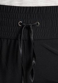Raiski - JUBILEE  - Pantalon de survêtement - black - 3