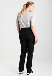 Raiski - JUBILEE  - Pantalon de survêtement - black - 2