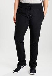 Raiski - JUBILEE  - Pantalon de survêtement - black - 0