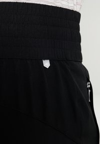 Raiski - JUBILEE  - Pantalon de survêtement - black - 5