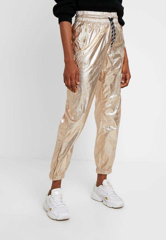 Tracksuit bottoms - bronze