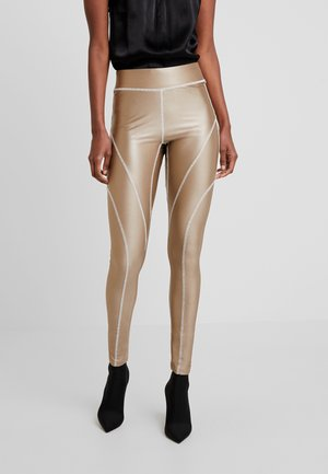 YOGA OVERLOCK - Leggings - gold