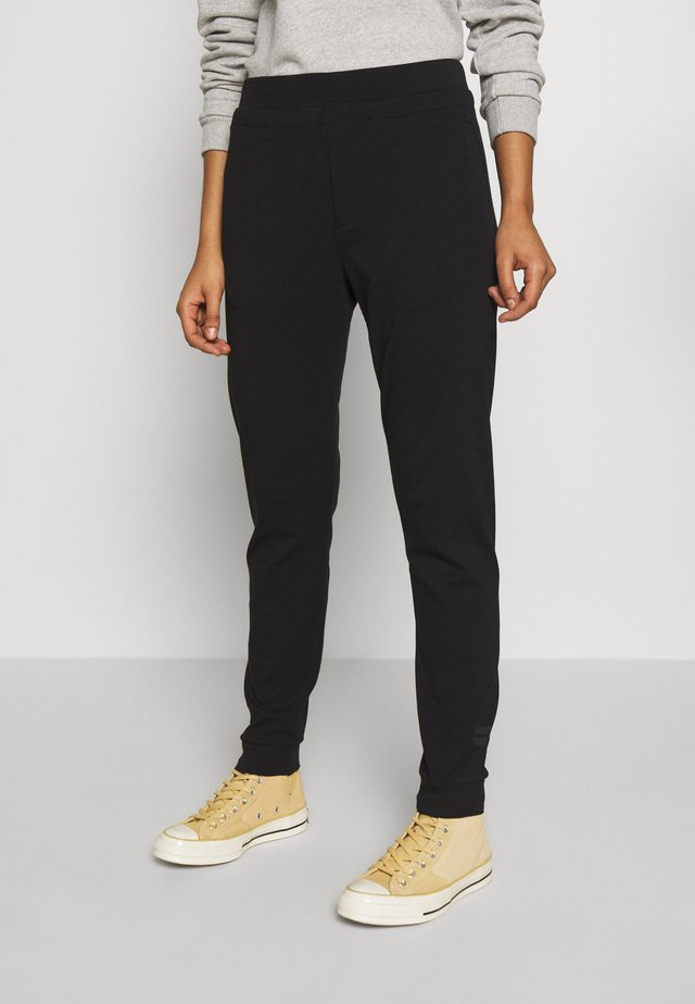 SOFT CHINO  - Tracksuit bottoms - black