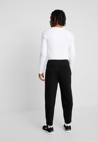 Kappa - AUTHENTIC BISO - Trousers - black/white - 2