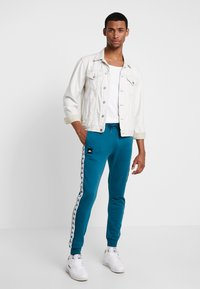 Kappa - FILL - Tracksuit bottoms - blue coral - 1