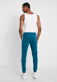 Kappa - FILL - Tracksuit bottoms - blue coral - 2