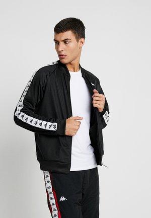 EGIL - Training jacket - black