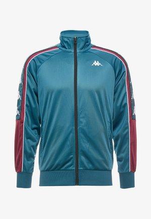 BANDA AHRAN - Training jacket - petrol/violet/white