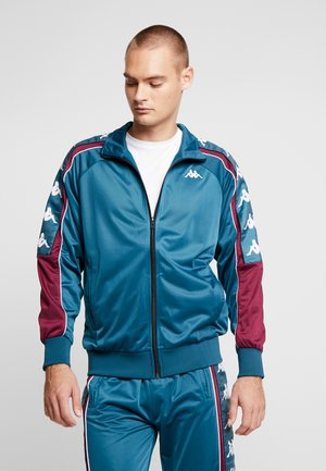 BANDA AHRAN - Training jacket - petrol/violet/white