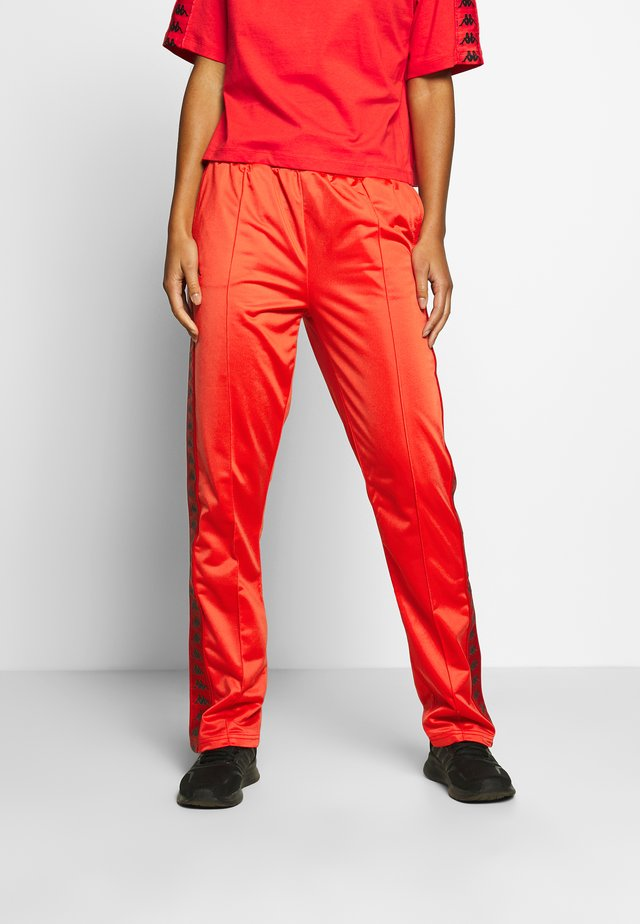 GELANIA - Jogginghose - poppy red
