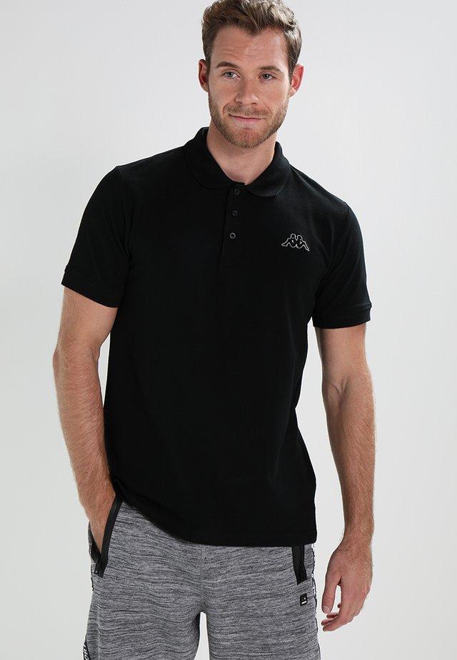PELEOT - Poloshirt - black