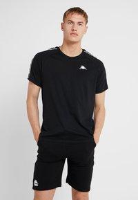 Kappa - FINLEY - T-shirt med print - caviar - 0
