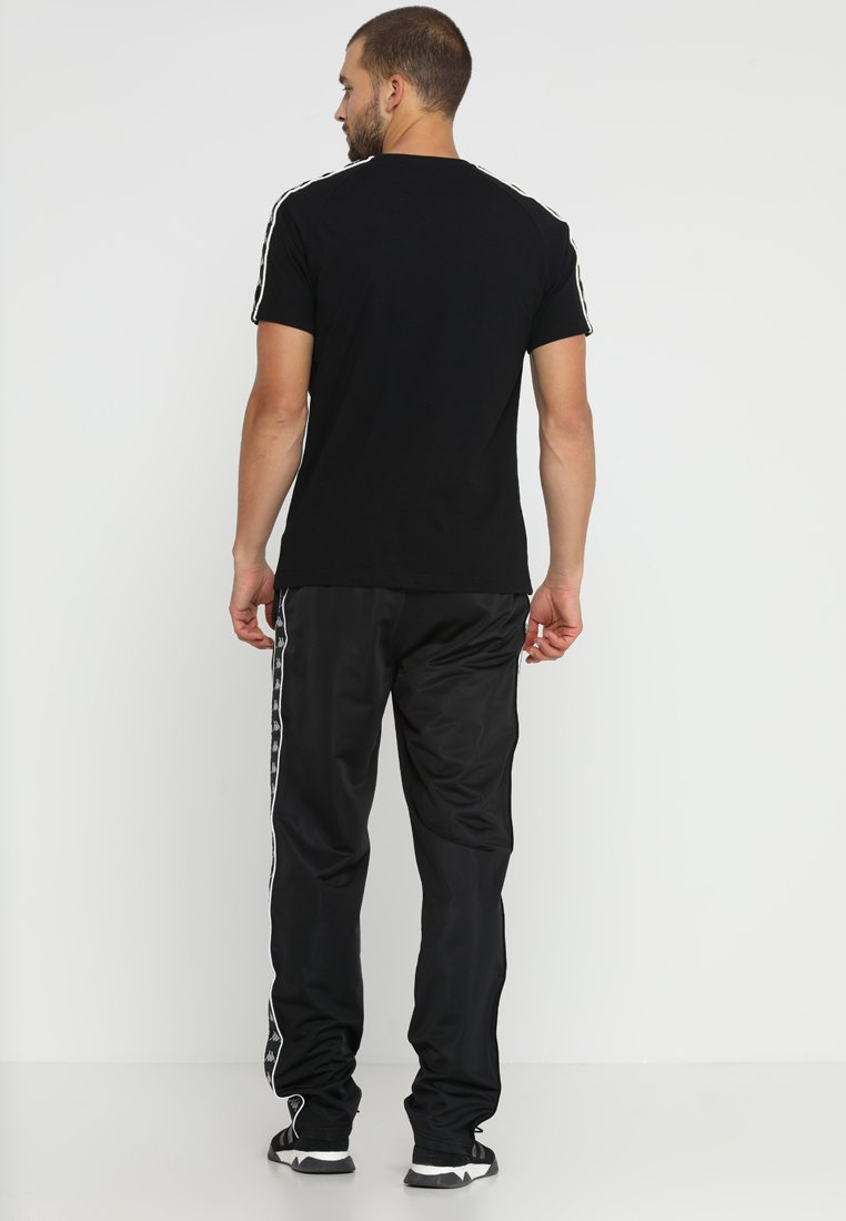 Kappa ENNO Pantalon de survêtement black ZALANDO.FR