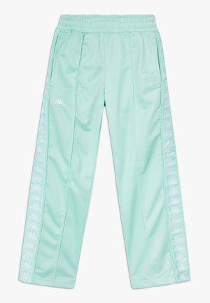 GELANIA - Pantaloni sportivi - yucca