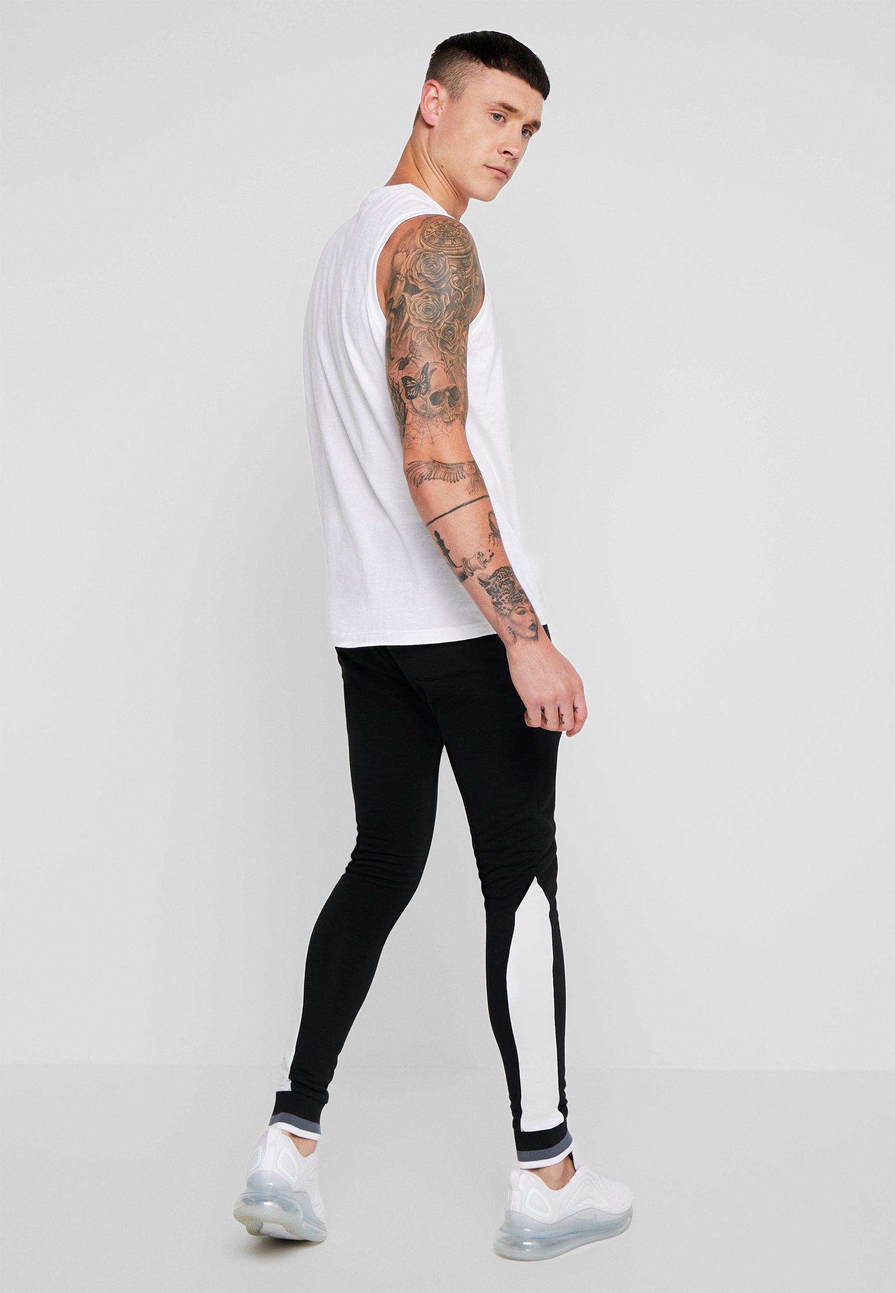 11 DEGREES RIBBED SKINNY JOGGERS - Spodnie treningowe - white/black - Odzież męska 2020