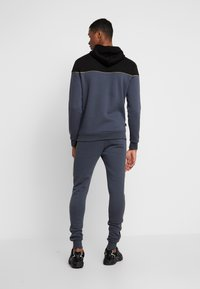 11 DEGREES - SKINNY  - Tracksuit bottoms - black/anthracite/goldpiping - 2
