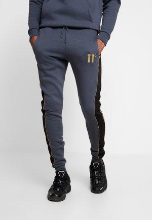 SKINNY  - Pantalon de survêtement - black/anthracite/goldpiping