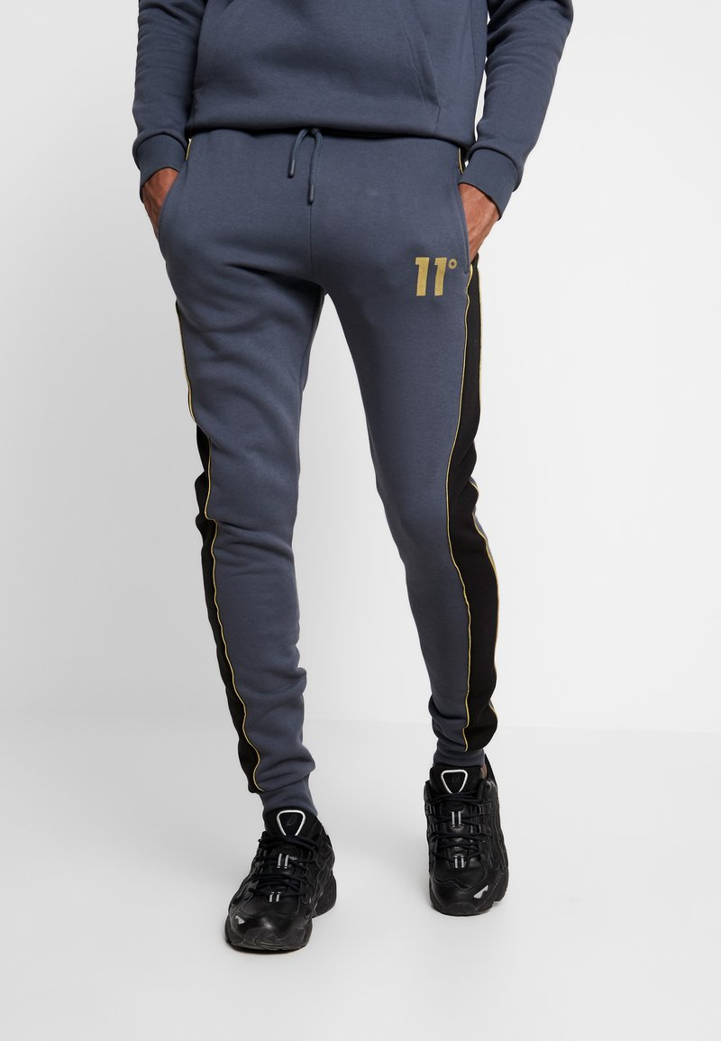 11 DEGREES - SKINNY  - Tracksuit bottoms - black/anthracite/goldpiping
