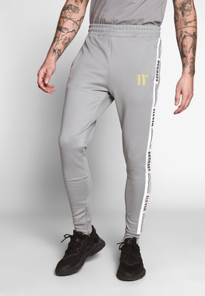 ASYMMETRIC TRACK PANTS - Tracksuit bottoms - silver