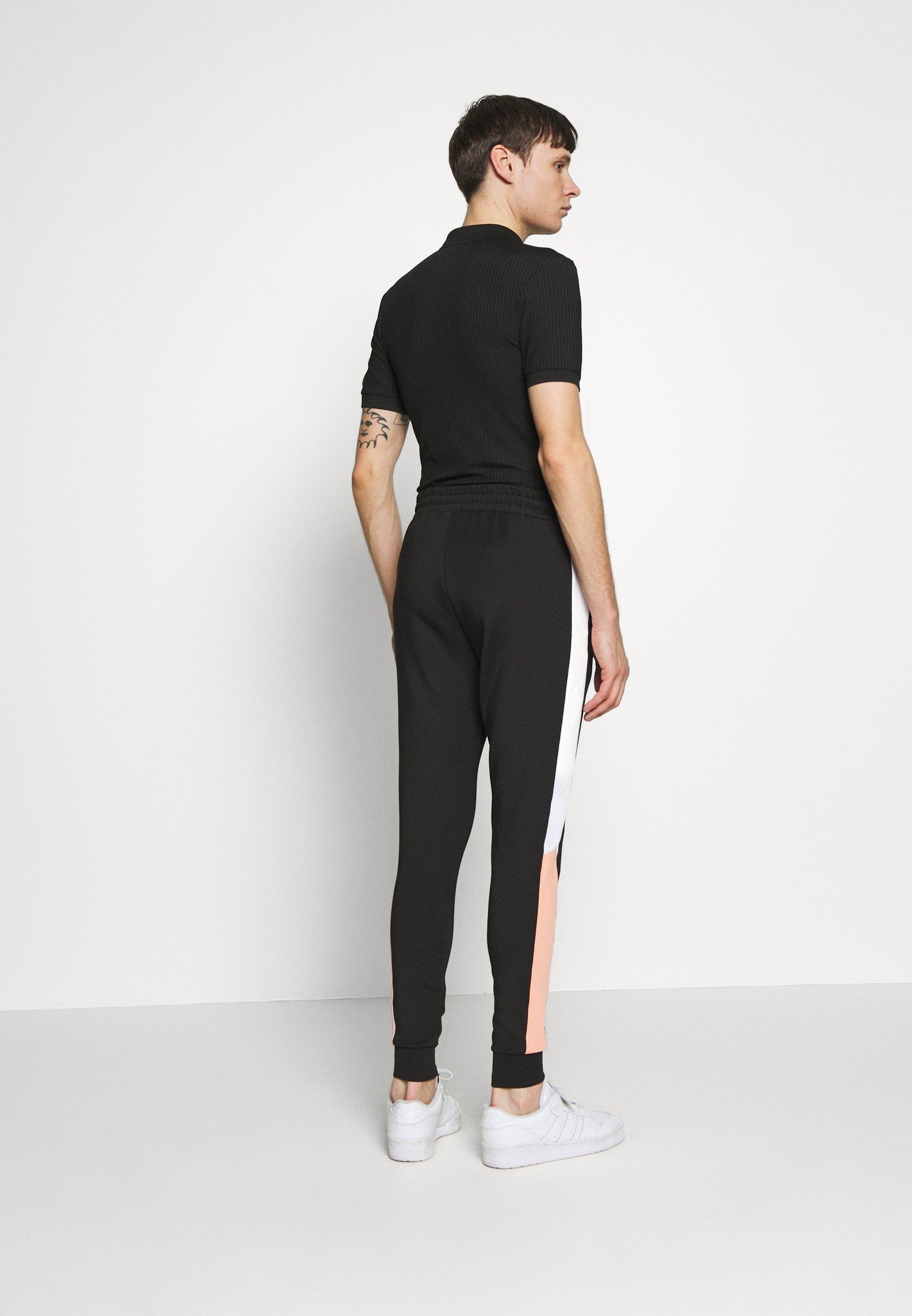 11 DEGREES PANEL BLOCK TRACK PANTS - Spodnie treningowe - peach melba/black/white