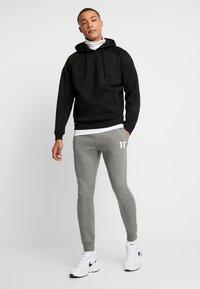 11 DEGREES - CORE JOGGERS  - Pantalones deportivos - charcoal - 1