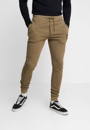 CORE JOGGERS  - Tracksuit bottoms - khaki