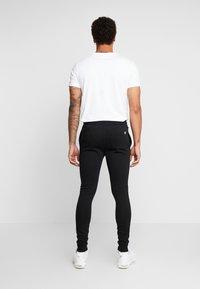 11 DEGREES - CORE JOGGERS  - Spodnie treningowe - black - 2