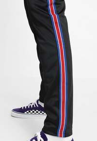 12 Midnight - HERITAGE TAPE JOGGER - Verryttelyhousut - black - 6