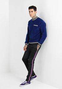 12 Midnight - HERITAGE TAPE JOGGER - Verryttelyhousut - black - 1