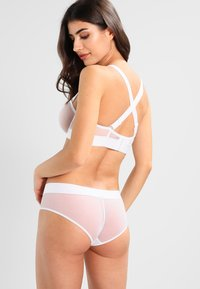 DKNY Intimates - SHEERS CONVERTIBLE STRAPLESS BRA - Underwired bra - white - 3