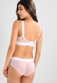 DKNY Intimates - WIREFREE SOFTCUP BRALETTE - Triangel BH - white