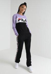 Fila - THORA TRACK PANTS - Teplákové kalhoty - black - 1