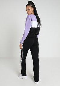 Fila - THORA TRACK PANTS - Teplákové kalhoty - black - 2