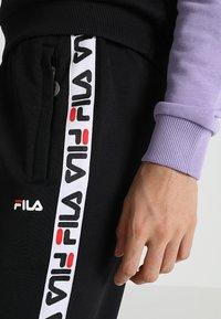 Fila - THORA TRACK PANTS - Teplákové kalhoty - black - 5