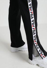 Fila - THORA TRACK PANTS - Teplákové kalhoty - black - 3