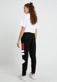 Fila - PURE BASIC PANTS - Teplákové kalhoty - black - 2