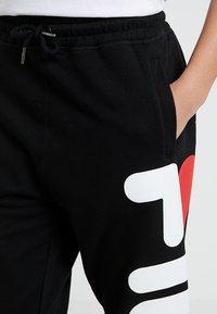Fila - PURE BASIC PANTS - Teplákové kalhoty - black - 5