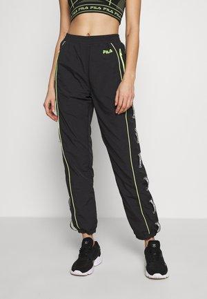 UNA - Pantalon de survêtement - black