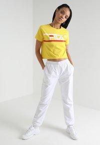 Fila - ASHLEY CROPPED TEE - T-shirt print - empire yellow - 1