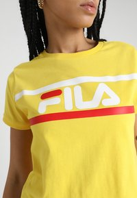 Fila - ASHLEY CROPPED TEE - T-shirt print - empire yellow - 6