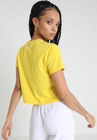 Fila - ASHLEY CROPPED TEE - T-shirt print - empire yellow - 2