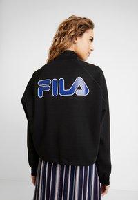 Fila - URA HALF ZIP  - Sweatshirt - black - 2