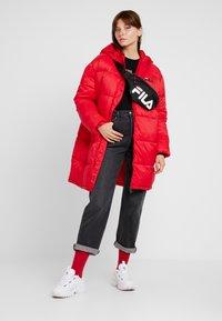 Fila - BRONWED PUFF HOOD JACKET - Zimní kabát - true red - 1