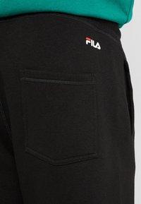 Fila - PURE BASIC PANTS - Verryttelyhousut - black - 5